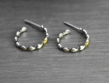 Against the current. Dainty hoop earrings.