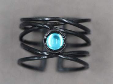 Black 925 sterling industrial ring with a vintage stone