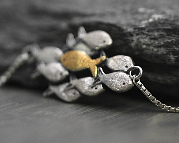Swimming against the current silver bracelet